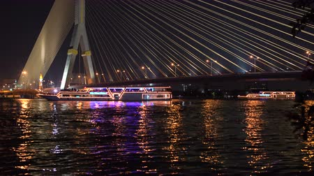 frigate : Recreational boats with lights are deployed on the river under the cable bridge. Part 1