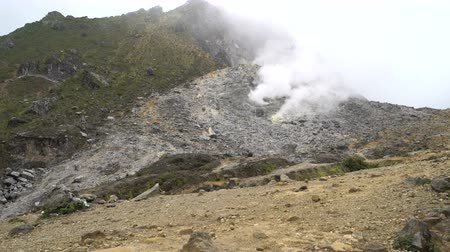 sulfur : Fuming Fumarola on top of a volcano Stock Footage
