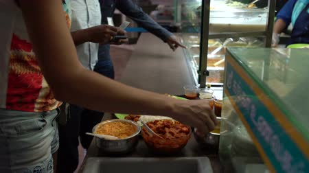 thali : Indian street food thali. Woman puts sauces in a plate