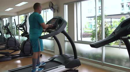 elliptical : Man is engaged in on the treadmill Stock Footage
