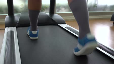 spotswear : Muzhkie legs are on a treadmill Stock Footage
