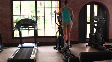 exercisemachine : A woman has an elliptical exerciser