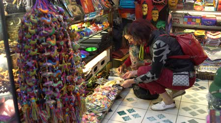 street market : Women in the gift shop choose magnets
