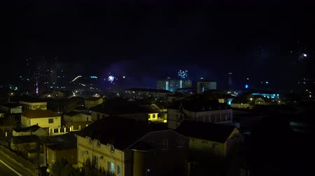 Happy New years Eve Fireworks over the city 影像素材