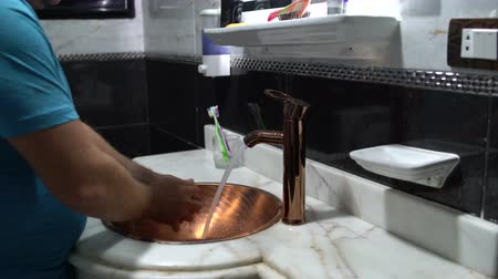 higiênico : Man soaping his hands with soap and washing his hands in the sink in the bathroom Stock Footage
