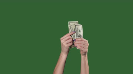 mevduat : Green screen. Chromakey. Woman hands counting money us dollars.