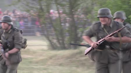 war field : Belarus, Brest - June 22, 2017: simulation of the battle of Brest fortress. German soldiers attack.