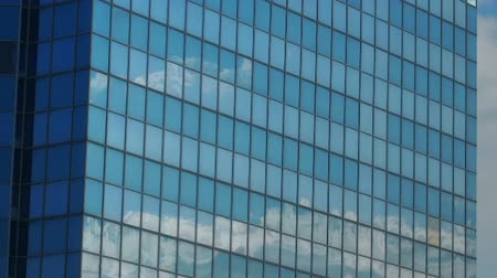 glass structure : Moving clouds reflected in a glass wall of the building. Time lapse
