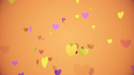 romance : Colored hearts floating slowly on an orange background.