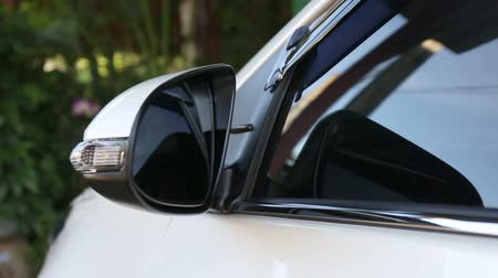 Drivers side mirror is automatic fold or manual control for white modern car
