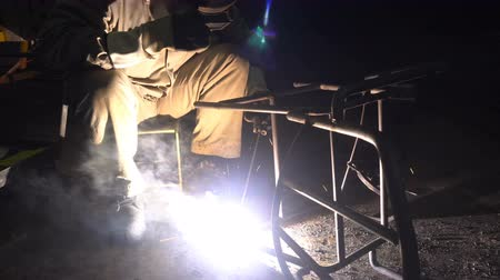 fire facilities : Workers grinding and welding in a factory or industry Stock Footage