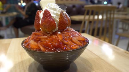 Bingsu, The shaved ice with slightly milk cream topped with cream cheese and fresh strawberry.