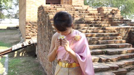 Thai woman in thai traditional dress in archaeological site Стоковые видеозаписи