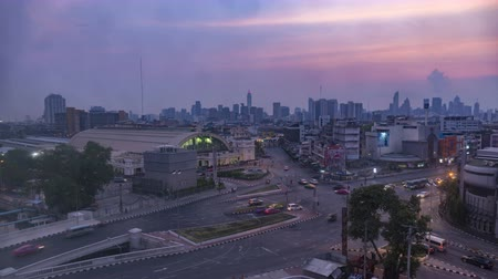 Bangkok night to day skyline. Aerial view traffic to Bangkok Hua Lamphong Railway Station.