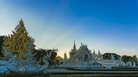 luang : Wat Rong Khun beautiful white temple famous landmark travel place and popular of Chiang Rai, Thailand in evening time 4K time lapse UHD.