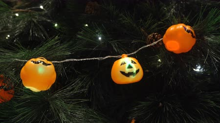 Pumpkins and character with light decorated on tree in a party to celebrate Halloween festival. Стоковые видеозаписи