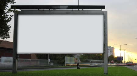 blank : Billboard on highway by day.