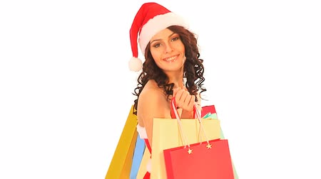 bustine : Donna in Santa cappello di shopping bag azienda. Filmati Stock