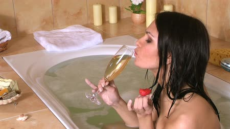 banyo : Woman drinking champagne. Stok Video