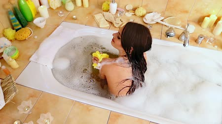 wanna : Young woman take bubble  bath. Top view. Used crane.