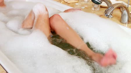 foam bath : Woman on treatment of varicose veins in bath.