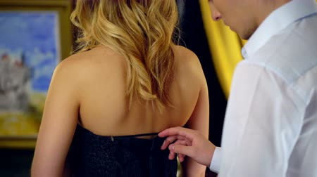 intim : Man undresses woman and unzip her dress. Romantic evening for loving couple.4k.