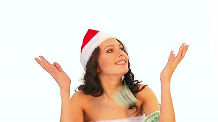 beatiful : Creative gift on Christmas sale for shopping woman in Santa hat holding bag which catches falling dollars money