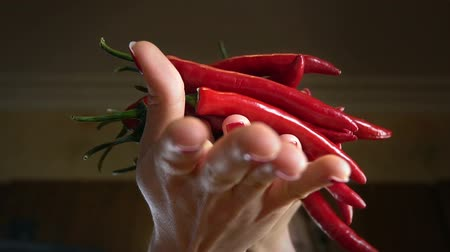 cins : Chili pepper pods jump in hands . Slow motion rustic country style for farm organic products. Stok Video