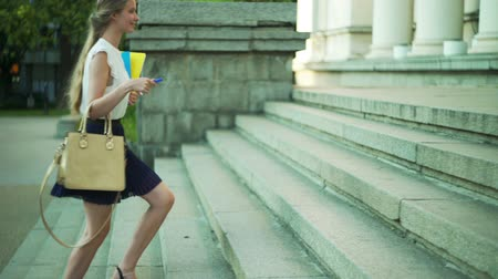 дверь : Higher education by happy girl freshwoman student go to university and runs on steps up on lesson.