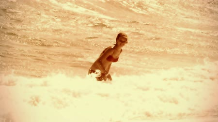 Slow motion of sea wave girl running sand. Vintage sepia old film effect by vacation in beach hotel.