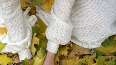 Close up of neckline girl and hands with autumn leaves then beautiful face in fashion and lifestyle lyrics style. Wideo