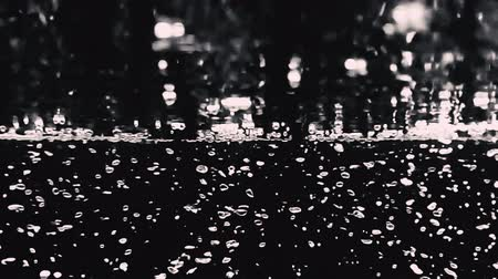 tlen : Blurry videos slow-motion of soda bubbles floating to top of surface which represent refreshing of carbonate drink such as cola or beer or sparkling mineral water and black background.