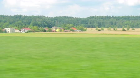 modern train wagon : Train moving through green grassed countryside