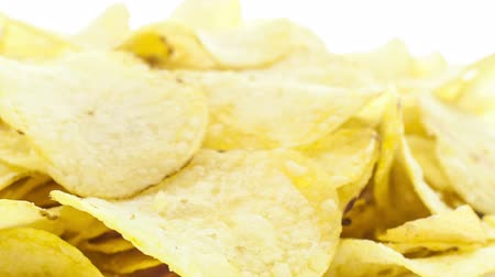 brambory : Potato chips rotating on the white table with white seamless background