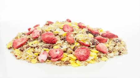 ve slupce : Mixed muesli rotating on the white table with white seamless background Dostupné videozáznamy