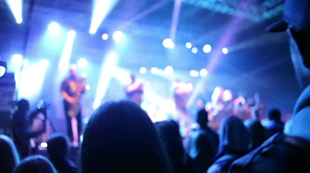 musicians stage : Crowded Concert with flashing stage lights