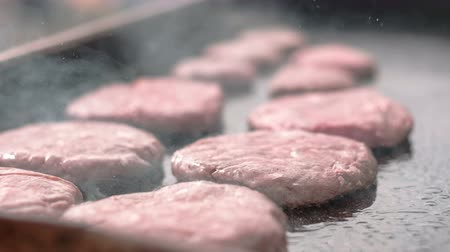 trimmings : Raw minced meat being cooked on the grill