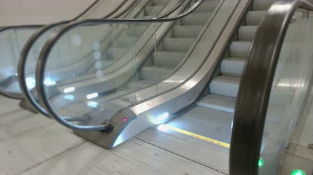 прихожая : Side view of escalator stairs running up