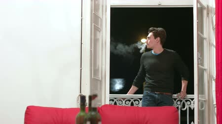 fumegante : Young Adult Smoking on the Balcony Stock Footage