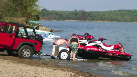 WAYNESVILLE - SEPTEMBER 8: Time lapse of two young men (names withheld) from Waynesville, OH load up their jet skis at Caesar Creek State Park September 8, 2007 in Waynesville, OH.