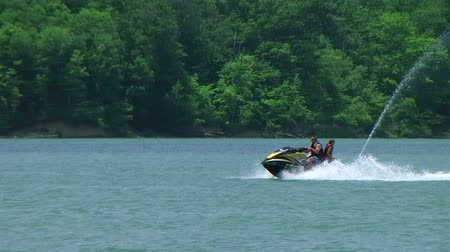 WAYNESVILLE - JULY 8: A young couple (names withheld) from Waynesville, OH cooling off on their jet ski on a hot July afternoon at Caesar Creek State Park July 8, 2009 in Waynesville, OH. Dostupné videozáznamy
