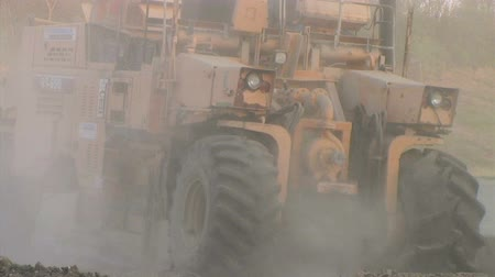 gerekçesiyle : Heavy equipment working slowly crushing pavement on construction site. NOTE: No modelproperty release  for this clip; may be suitable for editorial (news and documentary) usage only.