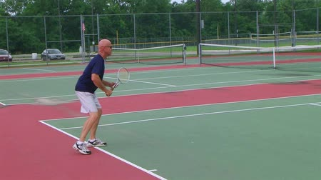 tennis game : Tennis player rushes net for overhead smash to win the match, crane shot. Stock Footage