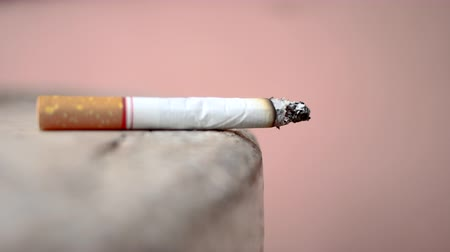 carcinogenic : Close up cigarette on table.