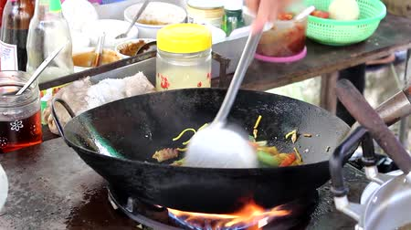 Chef cooking Fried noodle Yellow Market in Thailand