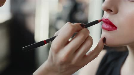 Lipstick on red lips of fashion model