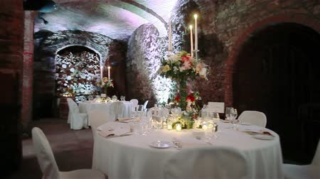 event : Wedding tables in wine cellar. Flycam, 2 shots in a sequence