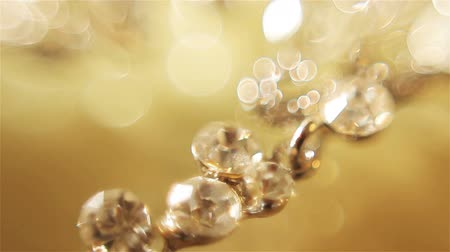 złoto : Diamond earrings. Gold. Smooth focus shifting, macro