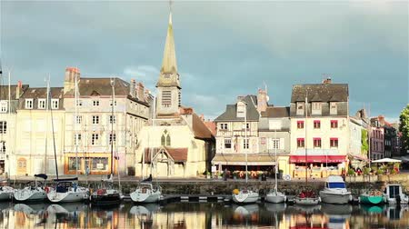 honfleur : Outside view of Saint Catherins church from Honfleur fishing port and reflection in water. 2 shots Stock Footage