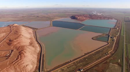 potash : 4k areal view flying over colorful water basins. Situated near Soligorsk city in Belarus, huge artificial mountains are formed by waste left after potash salt extraction from underground mines